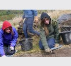 school pupils excavating